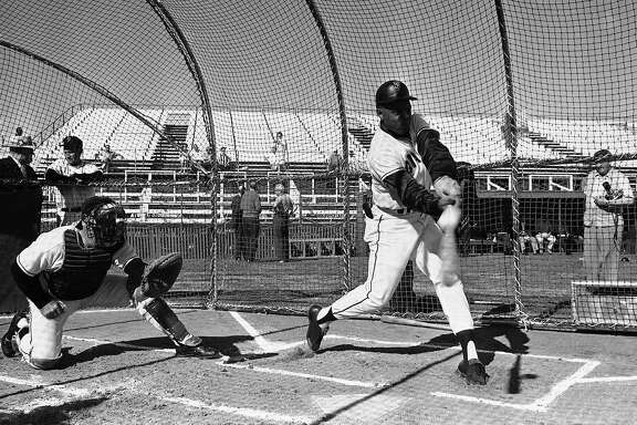 Willie Mays, centerfielder for the San Francisco Giants takes his turn in the batting at the Giants spring training camp in Casa Grande, Arizona. on Feb. 26, 1963.    At the catchers spot is Coach Wes Westrum.  (AP Photo)