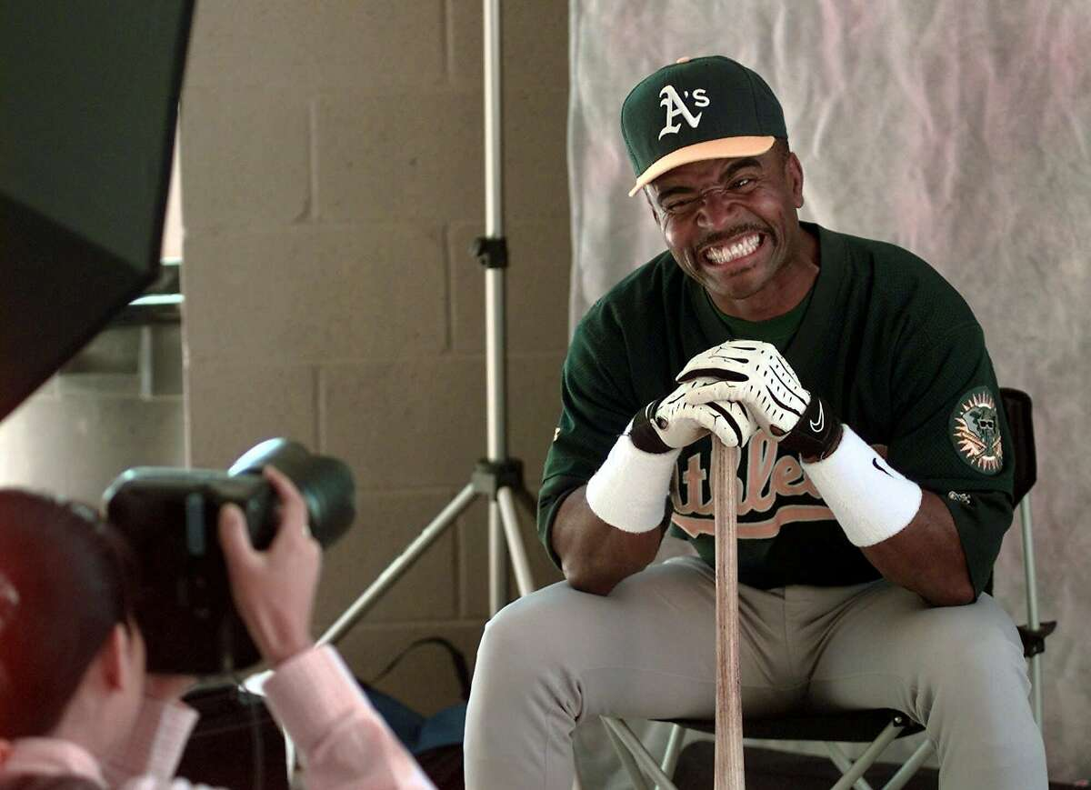 Oakland Athletics' Tony Phillips flashes a big smile for Miwako Mizumi of Baseball Magazine in Japan during spring training photo day at the Athletics camp in Phoenix, Ariz., Tuesday March 2, 1999.