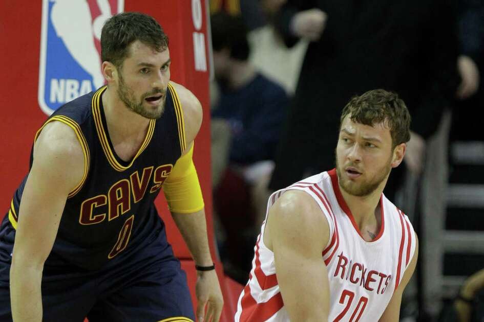 Houston Rockets Donatas Motiejunas looks to pass from the floor around Cleveland Cavaliers Kevin Love during first half of NBA game at Toyota Center Sunday, March 1, 2015, in Houston. ( Melissa Phillip / Houston Chronicle )
