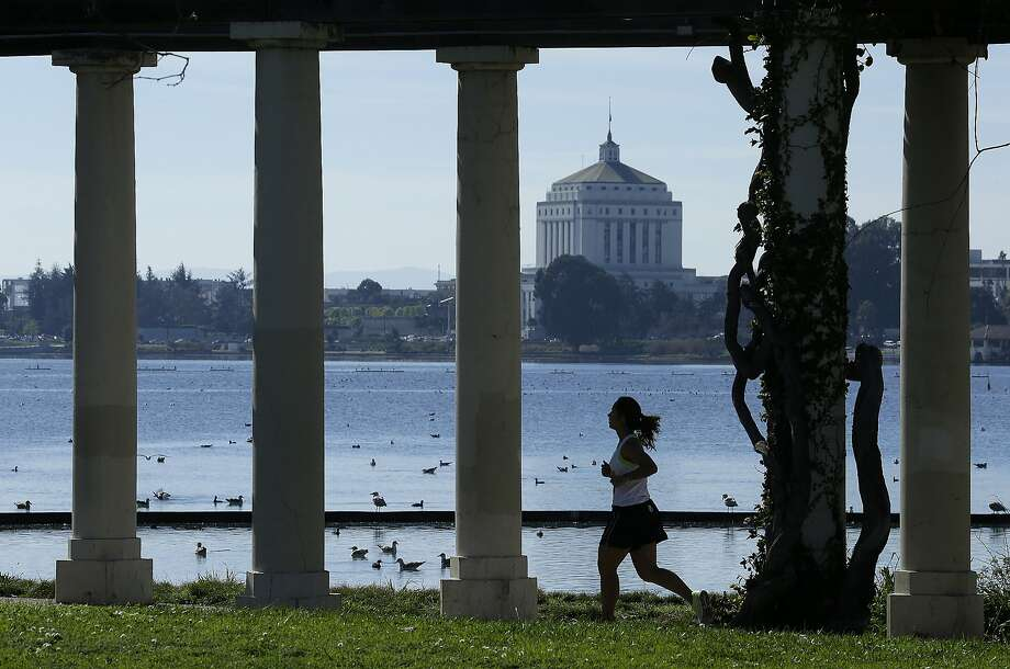 A woman jogs around Lake Merritt. Photo: Ben Margot, Associated Press