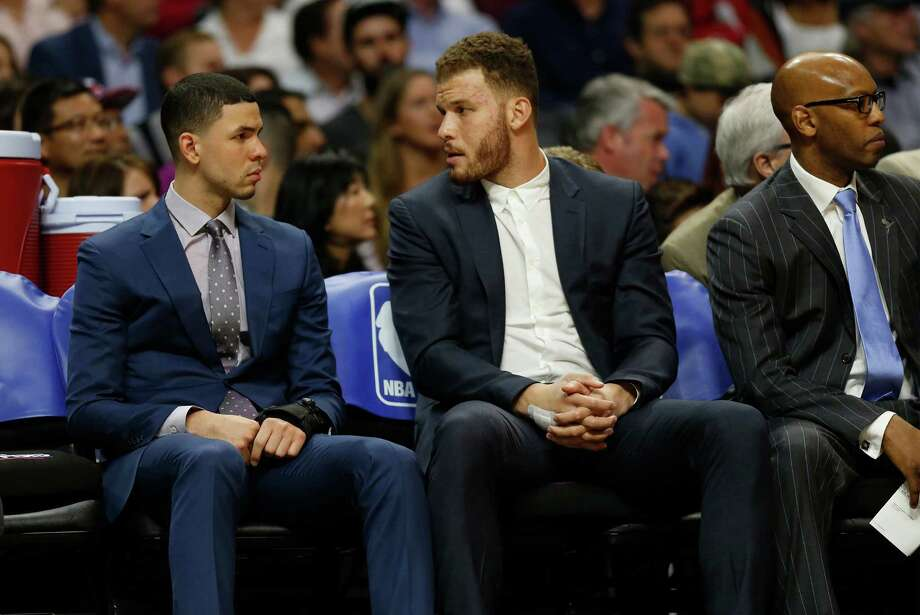 Injured Los Angeles Clippers guard Austin Rivers, left, and forward Blake Griffin talk on the bench during a game against the San Antonio Spurs at Staples Center in Los Angeles on Thursday, Feb. 18, 2016. (Gina Ferazzi/Los Angeles Times/TNS) Photo: Gina Ferazzi, McClatchy-Tribune News Service / Los Angeles Times