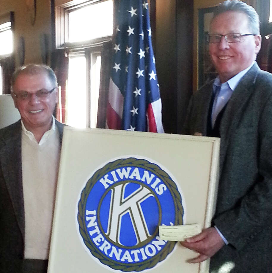 Members of the Kiwanis Club of Fairfield recently donated $10,000 to help the Wakeman Boys & Girls Club buy a new van. Tom Maniscalco, left, the president of the Fairfield Kiwanis, is shown donating the check to Dave Blagys, executive director of the Wakeman club. Photo: Contributed Photo / Fairfield Citizen