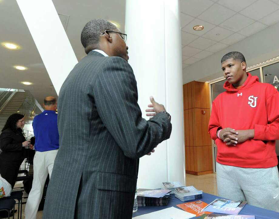 Stamford High School junior, DeVonte Henley, 17, listens as Josiah Lindsay, an executive with the 100 Black Men of Stamford organization, speaks about the college admissions process during the annual Black Men of Stamford, Inc., College Fair and Scholarship Symposium at the UConn Stamford Campus, Conn., Saturday, Oct. 24, 2015. Henley said that he will be studying accounting when he attends college. The 100 Black Men of Stamford is an organization that is devoted to the development and advancement of minority youth. Photo: Bob Luckey Jr. / Hearst Connecticut Media / Greenwich Time