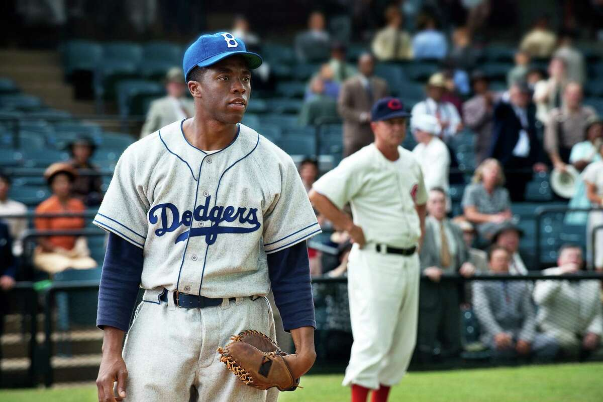 42 Year released: 2013 This biopic about baseball legend Jackie Robinson (played by Chadwick Boseman) chronicled his signing with the Brooklyn Dodgers and the watershed 1947 season in which he broke baseball's color barrier. The film doesn't sugarcoat the racism Robinson experienced, with a most uncomfortable scene in which Phillies manager Ben Chapman taunts him with a variety of racial epithets.