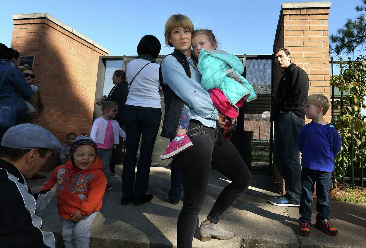 Jennifer Gerry holds onto her daughter, Marion, 3, as they wait to pick up her older daughter, Addison, 6, at Briargrove Elementary on Friday, Feb. 5, 2016 in Houston. (Elizabeth Conley/Houston Chronicle)