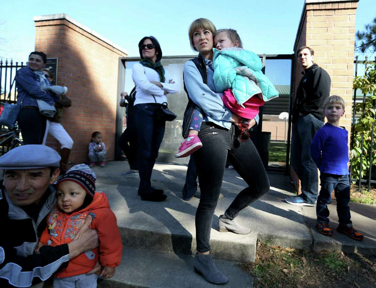 Jennifer Gerry and her daughter Marion, 3, waited to pick up Gerry's older child, Addison, 6, at Briargrove Elementary on Friday. Gerry said she sent Addison to school sick on the first day to avoid losing her spot. , Feb. 5, 2016 in Houston. (Elizabeth Conley/Houston Chronicle)