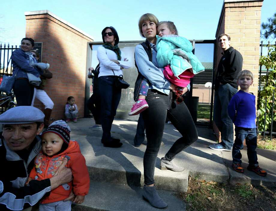 Jennifer Gerry and her daughter Marion, 3, waited to pick up Gerry's older child, Addison, 6, at Briargrove Elementary on Friday. Gerry said she sent Addison to school sick on the first day to avoid losing her spot. 