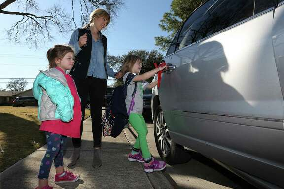 Jennifer Gerry, with daughter Marion, 3, picks up daughter Addison, 6, from highly rated Briargrove Elementary School.