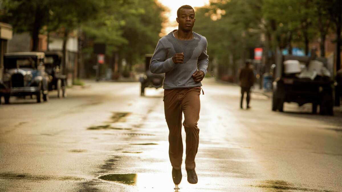 """This photo provided by Focus Features shows Stephan James as Jesse Owens in Stephen Hopkins' """"Race,"""" a Focus Features release. (Thibault Grabherr/Focus Features via AP)"""