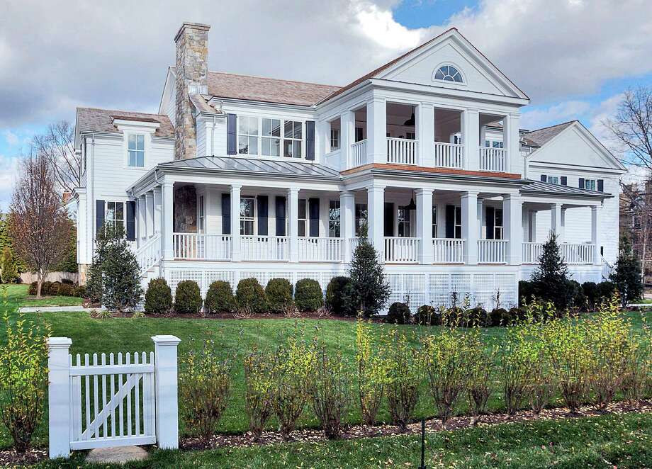 The newly built Colonial at 34 Owenoke Park is on the market for $5,195,000. Photo: Contributed Photos / Westport News