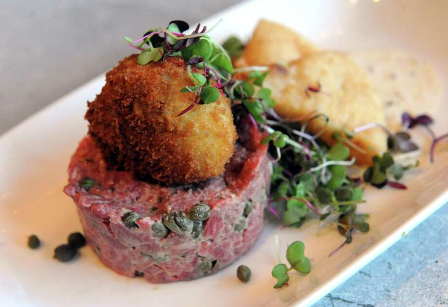 Click through the slideshow to learn about some dishes that delighted our restaurant critic. Steak Tartare($14.50). Black & Blue Steak and Crab, Guilderland. Read our review. Photo: Michael P. Farrell / 10033694A