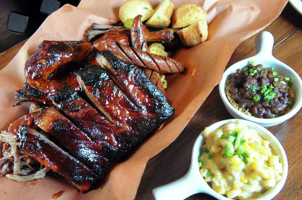 Barbecued meat (prices vary). Bull & Barrel Smokehouse, Latham. Read our review. In photo above, The Pit Master with ribs, smoked pulled pork, brisket, chicken and smoked jalapeno sausage with two sides mac and cheese and rice and beans.