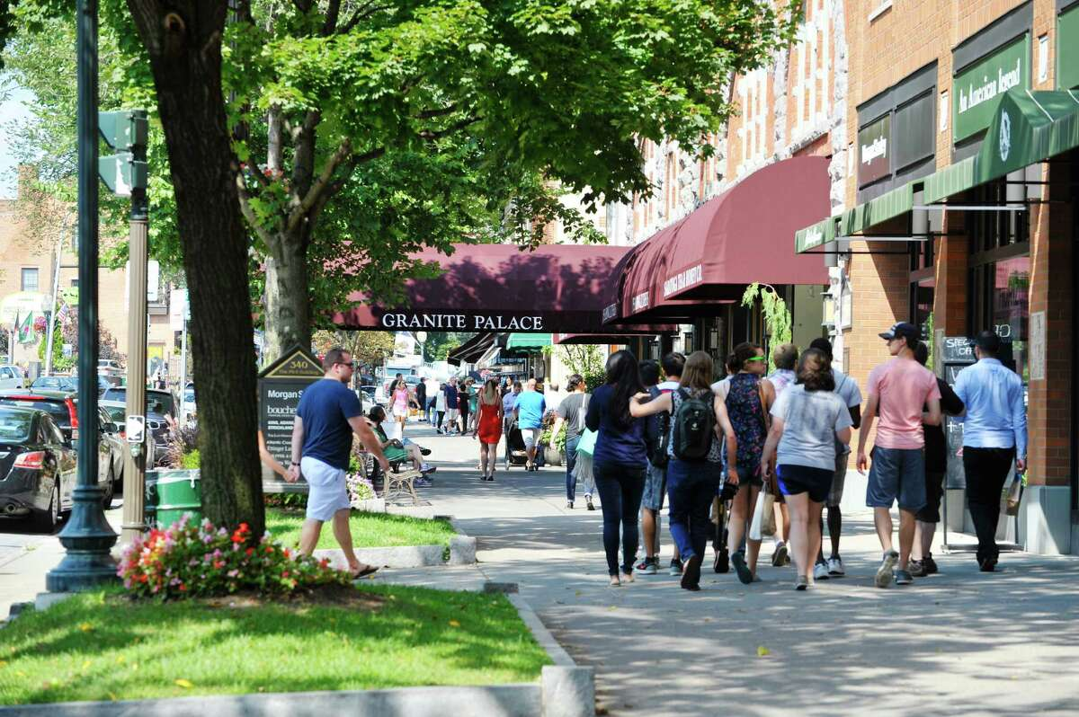 People make their way through downtown Saratoga Springs Monday, Aug. 24, 2015, in Saratoga Springs, N.Y. (Paul Buckowski / Times Union)