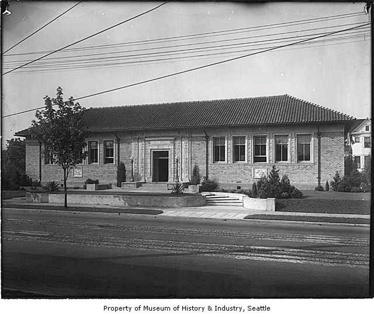 """""""The Yesler Library was built in 1914 and was named after Seattle pioneer Henry Yesler. The name was changed in 1975 at the request of neighborhood community members. Today it is the Douglass-Truth Library, named after Frederick Douglass and Sojourner Truth."""" The branch is shown here in about 1916. -MOHAI. Photo courtesy MOHAI, PEMCO Webster and Stevens Collection, image number 1983.10.10164.1."""