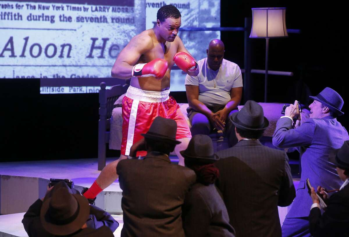 Kenneth Kellogg as young Emile Griffith gets attention from press as Arthur Woodley as older Emile Griffith, is seen at upper right during a dress rehearsal of Terence Blanchard's