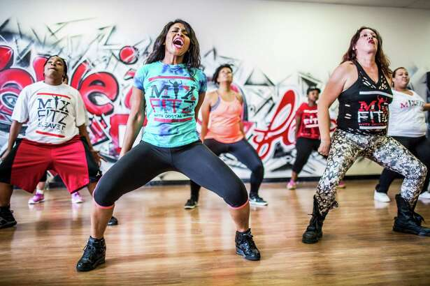 Dancing is a fun way to incorporate aerobic exercise in your lifestyle.   Pictured is Crystal Wall teaching a dance fitness in 2014 in Houston.
