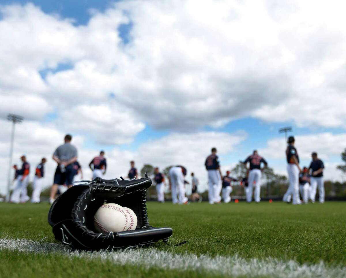 Players prepare for the first workout for Houston Astros pitchers and catchers for spring training in Kissimmee, Florida, Friday, Feb. 19, 2016.