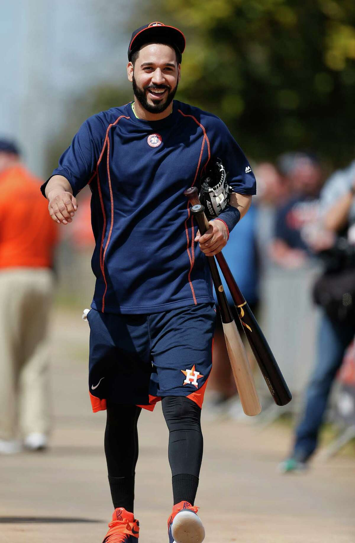 Houston Astros infielder Marwin Gonzalez laughs after returning from batting cages during the first workout for Houston Astros pitchers and catchers for spring training in Kissimmee, Florida, Friday, Feb. 19, 2016.