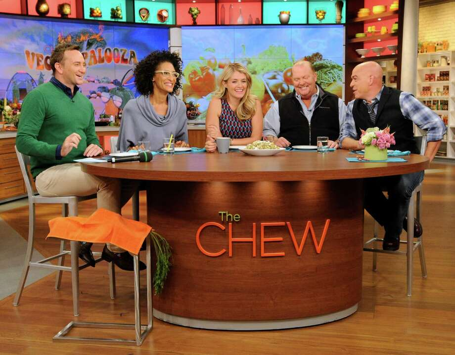 """FILE - This Sept. 17, 2013 photo shows the hosts of """"The Chew,"""" from left, Clinton Kelly, Carla Hall, Daphne Oz, Mario Batalu and Michael Symon in the studio in New York.The final episode of """"The Chew"""" is set to air on Friday, concluding its seven-year run. Photo: Jeff Neira, HOEP / American Broadcasting Companies,"""