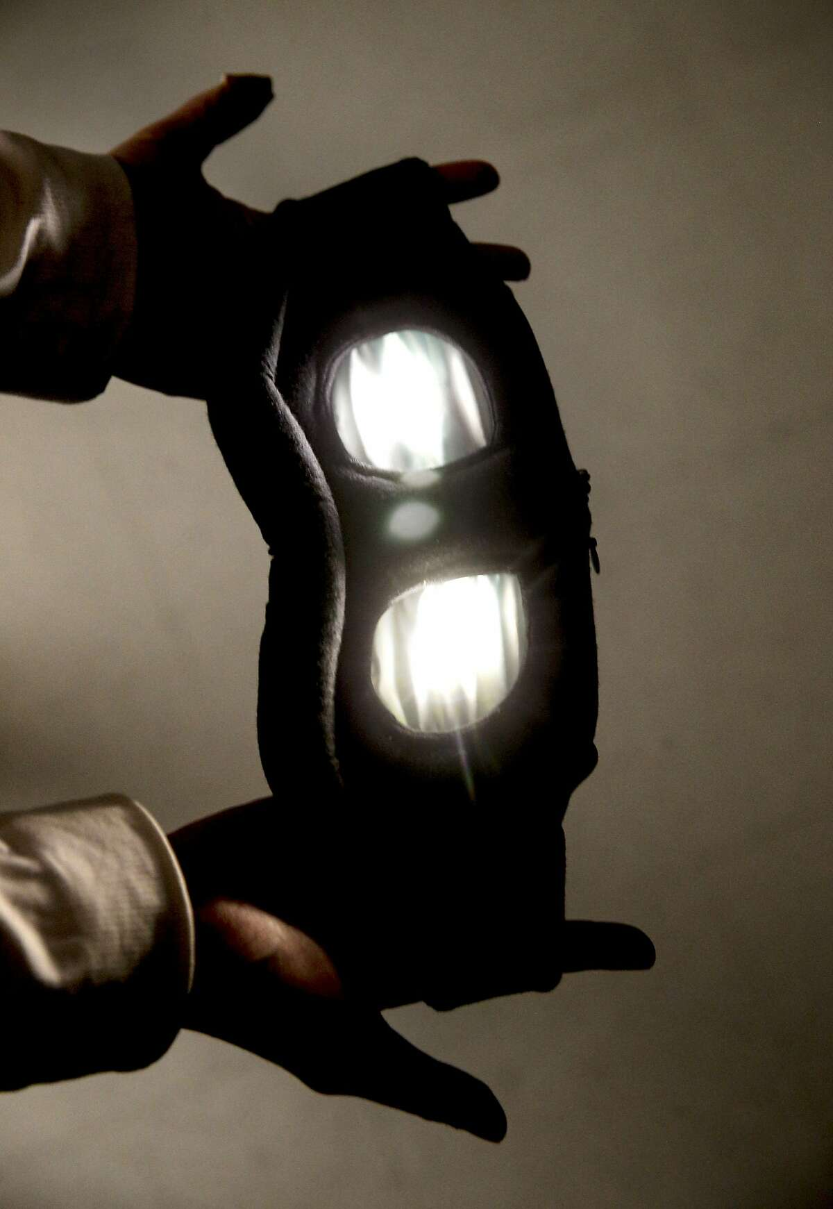 The mask's LED lights are controlled by a smartphone app.