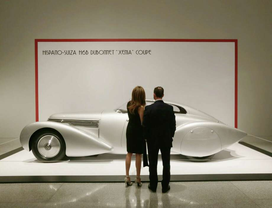 "A couple views a Hispano-Suiza ""Xenia"" Coupe at the patrons' dinner for ""Sculpted in Steel"" at the MFAH Wednesday, Feb. 17, 2016, in Houston.  ( Jon Shapley / Houston Chronicle ) Photo: Jon Shapley, Staff / © 2015  Houston Chronicle"