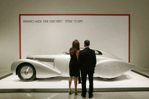 "A couple views a Hispano-Suiza ""Xenia"" Coupe at the patrons' dinner for ""Sculpted in Steel"" at the MFAH Wednesday, Feb. 17, 2016, in Houston.  ( Jon Shapley / Houston Chronicle )"