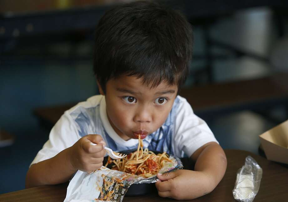 Kindergartner Colin Wolfert eats a spaghetti lunch from a recyclable plastic tray at Commodore Sloat School in San Francisco, Calif. on Friday, Feb. 19, 2016. Schools across the city have been asked not to place recyclable trays in recycle bins because of excess food particles clinging to them. Photo: Paul Chinn, The Chronicle