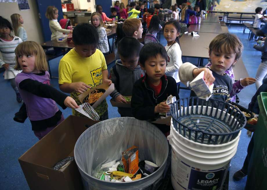 KIndergartners separate trash and recyclables after lunch at Commodore Sloat School in San Francisco, Calif. on Friday, Feb. 19, 2016. Schools across the city have been asked not to place recyclable trays in recycle bins because of excess food particles clinging to them. Photo: Paul Chinn, The Chronicle