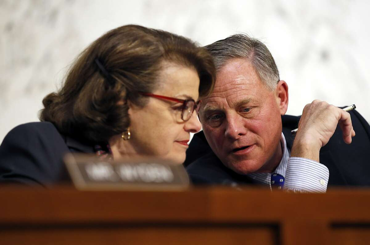 Vice Chairman Sen. Dianne Feinstein, D-Calif., left, and Chairman Sen. Richard Burr, R-N.C., talk during a hearing of the Senate Select Committee on Intelligence about worldwide threats, on Capitol Hill, Tuesday, Feb. 9, 2016 in Washington.