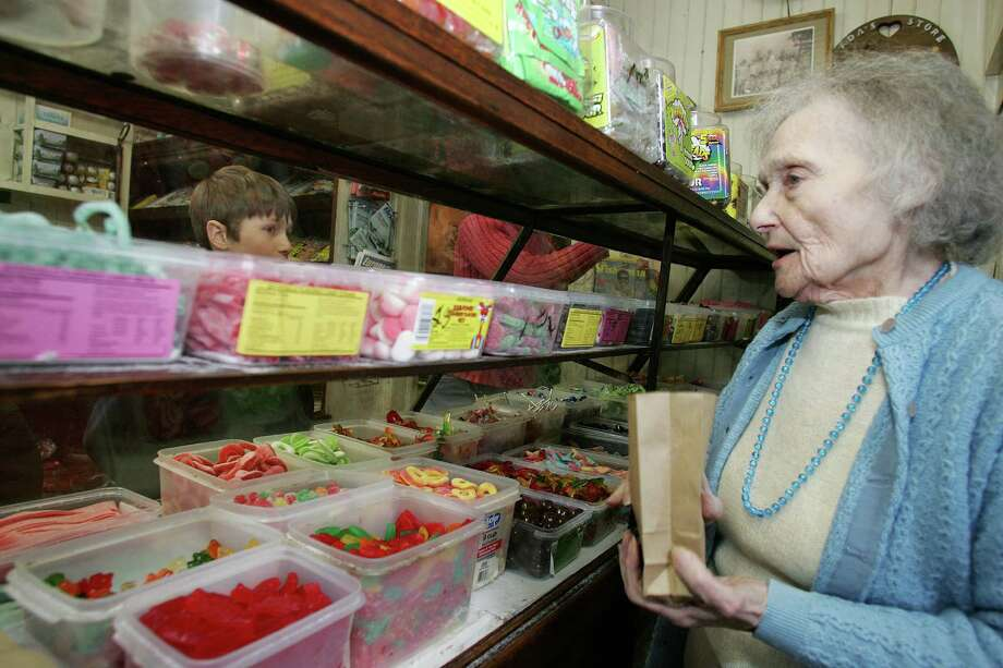 041807, Riverside.  Ada Cantavero helps with candy selection at her Variety Store in Riverside.  David Ames photo. Staff Photo Neafsey,Helen Photo: David Ames / GT / 00002703A