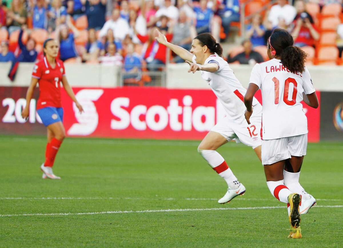 HOUSTON, TX - FEBRUARY 19: Christine Sinclair #12 of Canada celebrates after scoring a second half goal against Costa Rica during the Semifinal of the 2016 CONCACAF Women's Olympic Qualifying at BBVA Compass Stadium on February 19, 2016 in Houston, Texas.