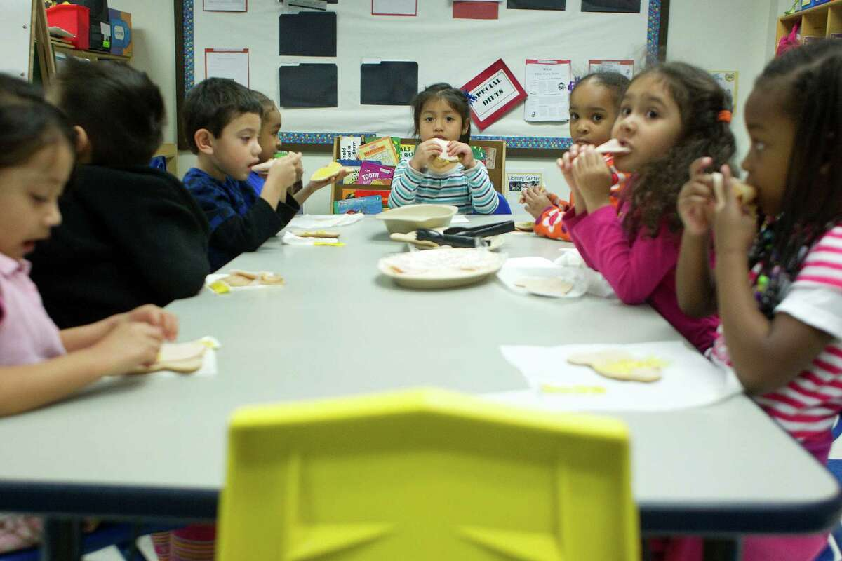 Deziree Ramirez, 3, center, eats an afternoon snack of turkey meat on a slice of low-fat bread after the children ate tofu and sweet potato french fries for their lunch at the Harris County Department of Education Head Start program in the 5th Ward Multiservice Center Thursday, Feb. 27, 2014, in Houston. Through the Child and Adult Care Food Program, this Head Start facility is able to provide children with healthy balanced lunches. ( Johnny Hanson / Houston Chronicle )
