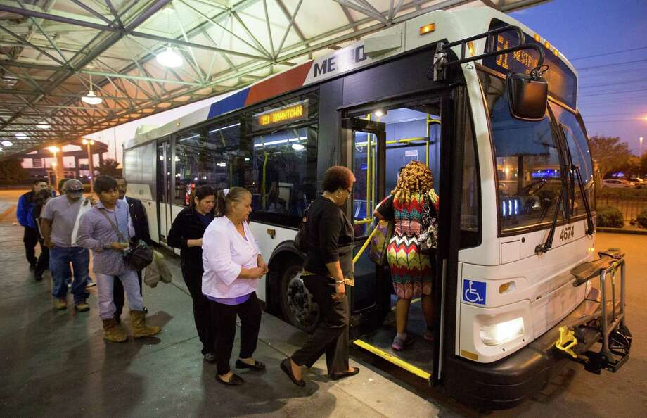 Riders board the 151 Westpark Express bus at the Hillcroft Park & Ride  in Houston. (Cody Duty / Houston Chronicle) Photo: Cody Duty, Staff / © 2015 Houston Chronicle