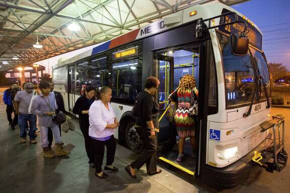 Riders board the 151 Westpark Express bus at the Hillcroft Park & Ride  in Houston. (Cody Duty / Houston Chronicle)