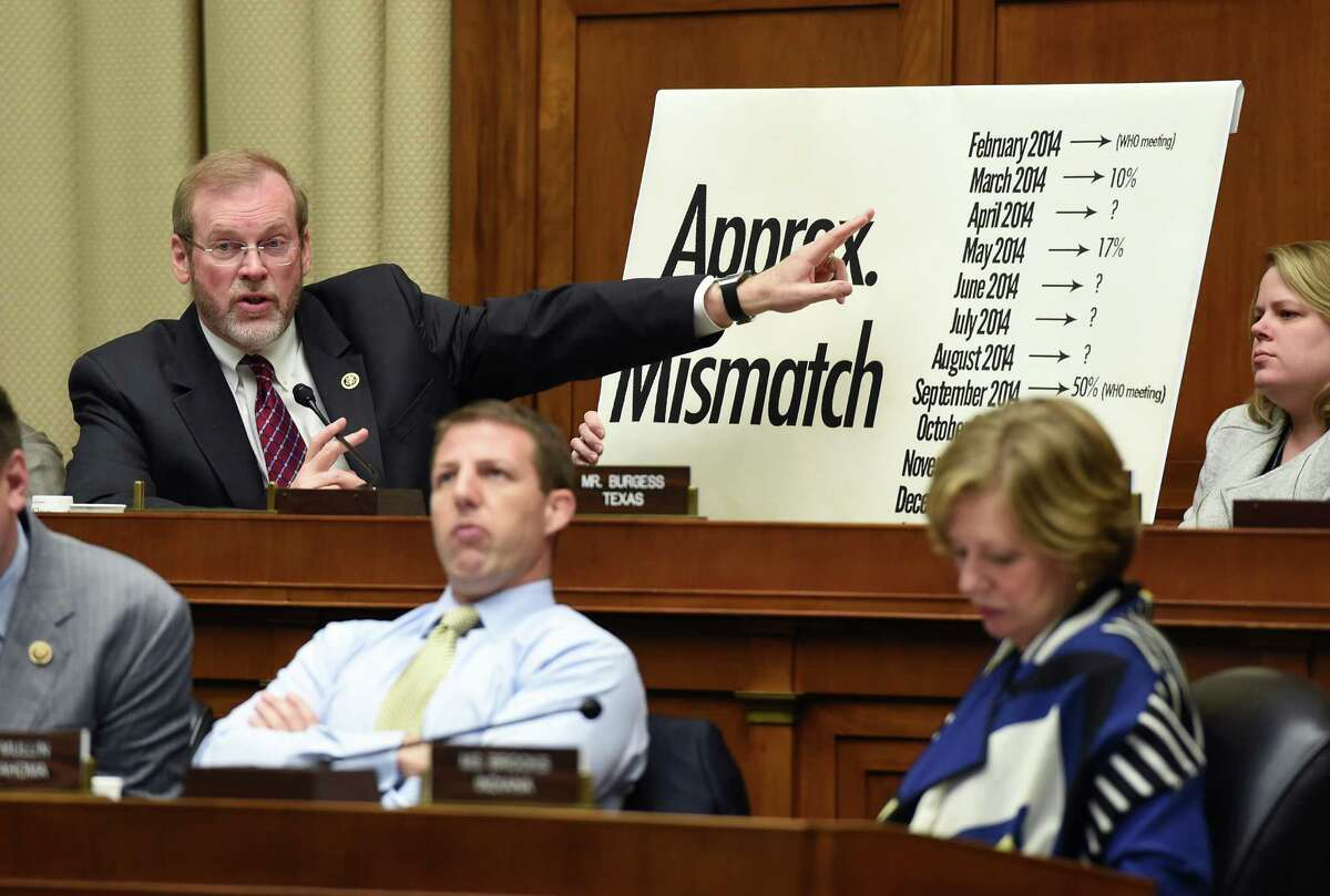 Rep. Michael Burgess, R-Texas, makes a point with a chart while questioning witnesses during a House Energy and Commerce subcommittee hearing looking into the effectiveness of vaccines in the wake of a measles outbreak and the exceptionally severe flu season, on Capitol Hill in Washington, Tuesday, February 3, 2015. (AP Photo/Molly Riley)