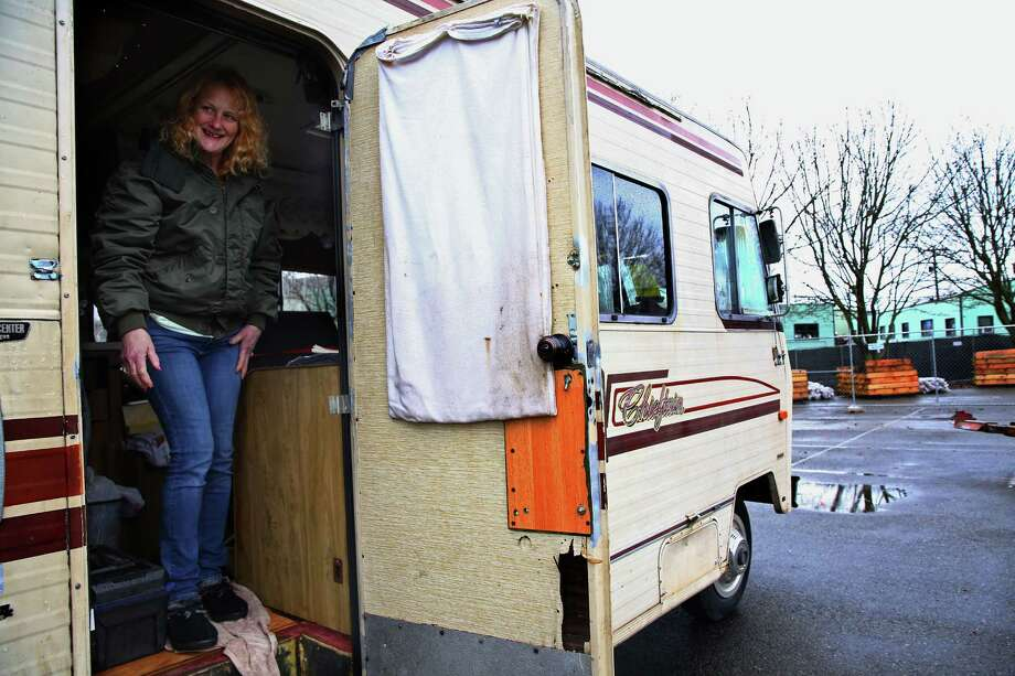 """Wanda Wiliams smiles out from her RV after it was the first vehicle moved to a new """"safe lot"""" at Shilshole Avenue and 24th Avenue NW in Ballard, Friday, Feb. 19, 2016.  Williams has been homeless for the past three years and is excited to have a spot in the new lot.  A second """"safe lot"""" location will open in Deldrige in two weeks. Photo: GENNA MARTIN, SEATTLEPI.COM / SEATTLEPI.COM"""