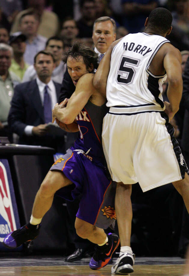Spurs' Robert Horry fouls Suns' Steve Nash late in Game Four of their second round playoff series on May 14, 2007 at the AT&T Center. Horry was ejected. The Suns went on to win 104-98. Photo: Express-News File Photo / SAN ANTONIO EXPRESS-NEWS