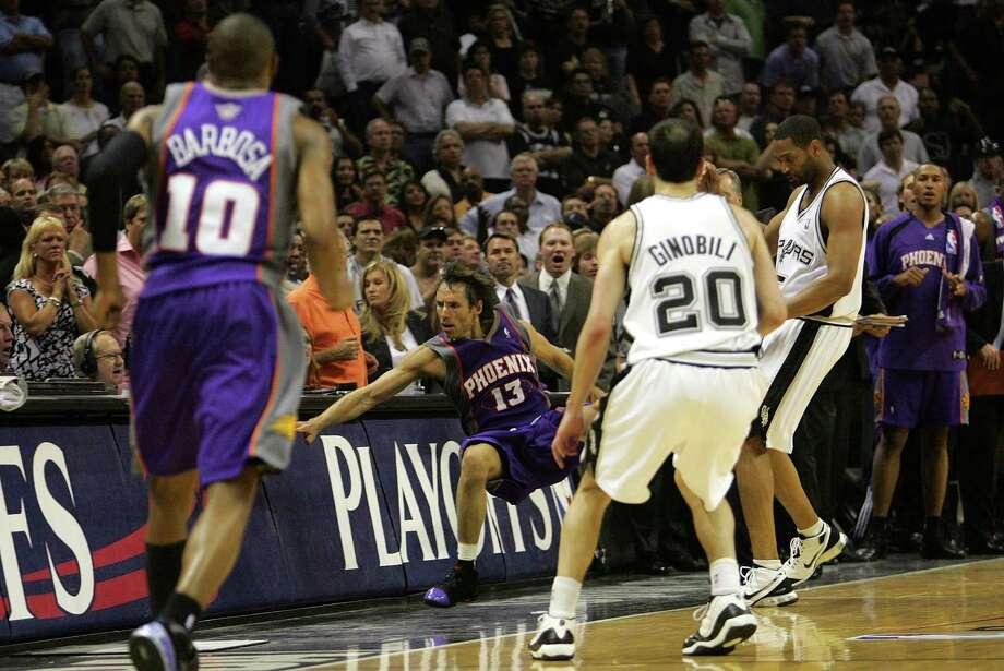 Guard Steve Nash of the Phoenix Suns falls out of bounds after a flagrant foul by Robert Horry of the San Antonio Spurs in Game 4 of the Western Conference semifinals during the 2007 NBA playoffs on May 14, 2007 at AT&T Center in San Antonio. Photo: Ronald Martinez /Getty Images / 2007 Getty Images