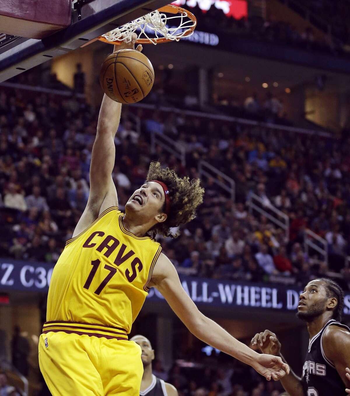 Former Cavaliers center Anderson Varejao dunks against the San Antonio Spurs on Nov. 19, 2014.