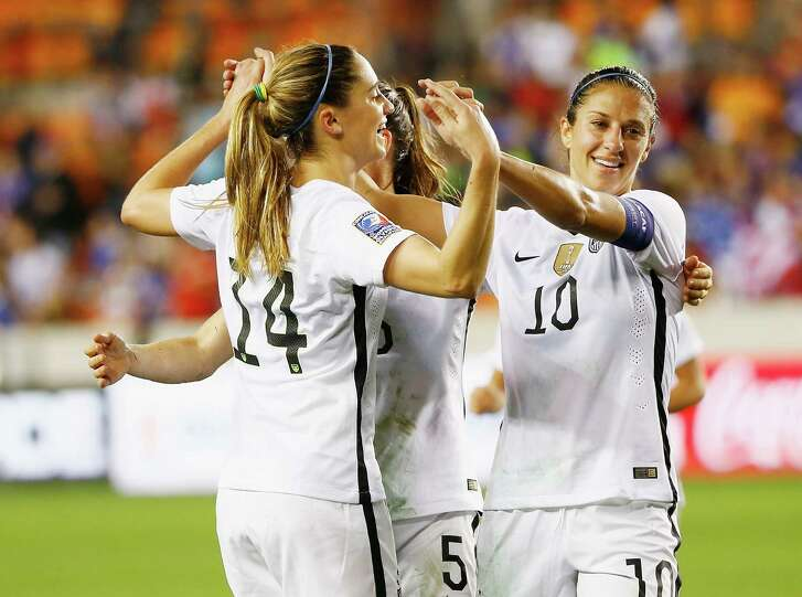 HOUSTON, TX - FEBRUARY 19:  Morgan Brian #14 and  Carli Lloyd #10 of the United States celebrate after Lloyd scored a goal in the first half of their game against Trinidad and Tobago during their Semifinal of the 2016 CONCACAF Women's Olympic Qualifying at BBVA Compass Stadium on February 19, 2016 in Houston, Texas.
