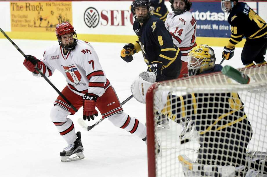 RPI's Zach Schroeder, left, gets the puck past Quinnipiac goalie Michael Garteig in the second period during their hockey game on Friday, Feb. 19, 2016, at Houston Field House in Troy, N.Y. (Cindy Schultz / Times Union) Photo: Cindy Schultz / Albany Times Union