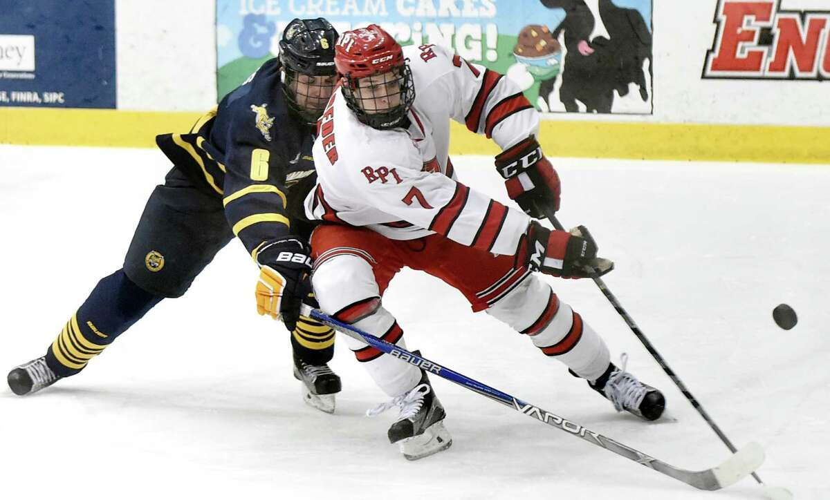 RPI's Zach Schroeder, right, battles for the puck with Quinnipiac's Devon Toews during their hockey game on Friday, Feb. 19, 2016, at Houston Field House in Troy, N.Y. (Cindy Schultz / Times Union)