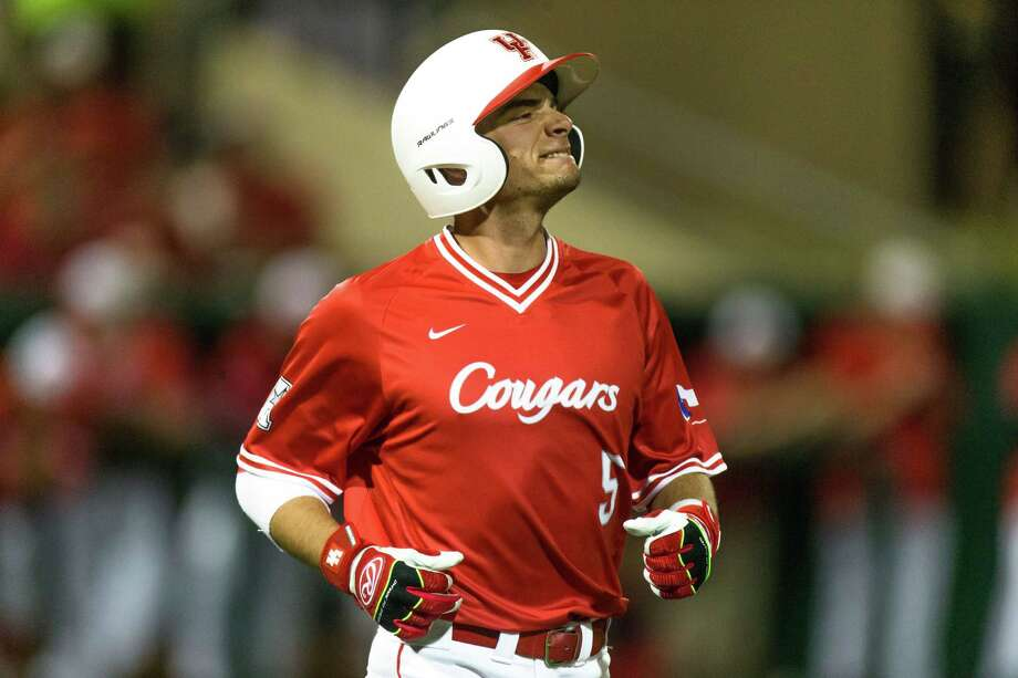 Houston infielder Connor Hollis (5) reacting after being hit in the elbow during the fourth inning of play betweenVillanova at University of Houston baseball game at the Darryl & Lori Schroeder Park, Friday, Feb. 19, 2016, in Houston. ( Juan DeLeon / For the Houston Chronicle ) Photo: Juan DeLeon, For The Chronicle / Houston Chronicle