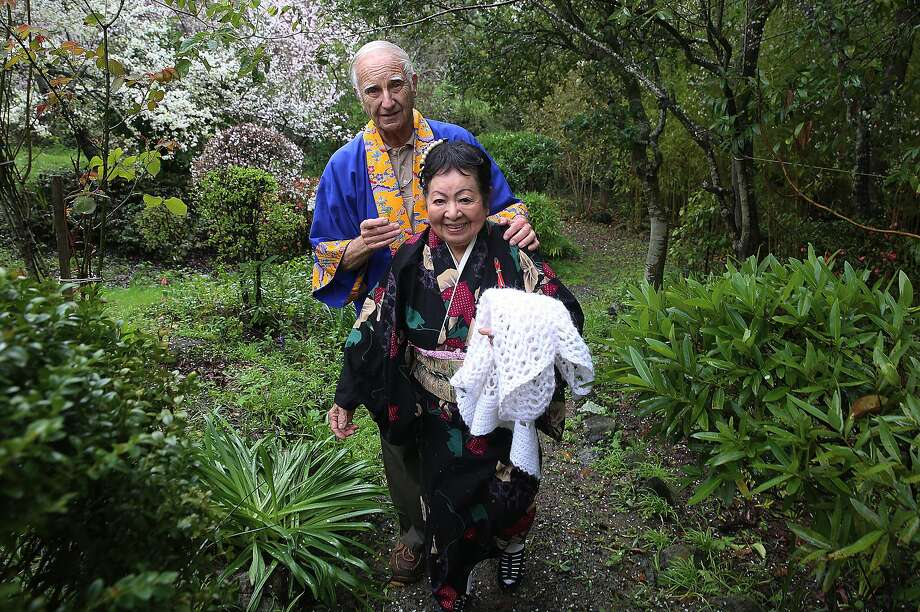 Maria Miyagi Bartuff, 85 years old, a survivor of the sinking of the Japanese freighter tsushima maru in 1944 when she was 13 years old shows her garden with her husband Dave Bartruff in San Anselmo, California, on Friday, February 19, 2016.  The ship carried over 700 school children and was torpedoed by a U.S. submarine. Photo: Liz Hafalia, San Francisco Chronicle