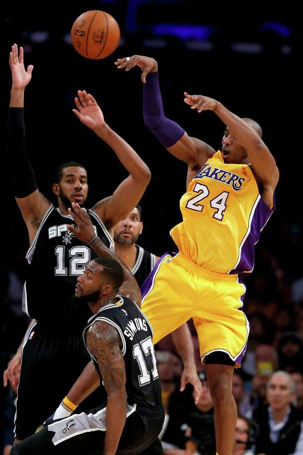 LOS ANGELES, CA - FEBRUARY 19: Kobe Bryant #24 of the Los Angeles Lakers passes the ball past Jonathon Simmons and LaMarcus Aldridge #12 of the San Antonio Spurs during the first half of a game at Staples Center on February 19, 2016 in Los Angeles, California. NOTE TO USER: User expressly acknowledges and agrees that, by downloading and or using this photograph, User is consenting to the terms and conditions of the Getty Images License Agreement. Photo: Sean M. Haffey, Getty Images / 2016 Getty Images