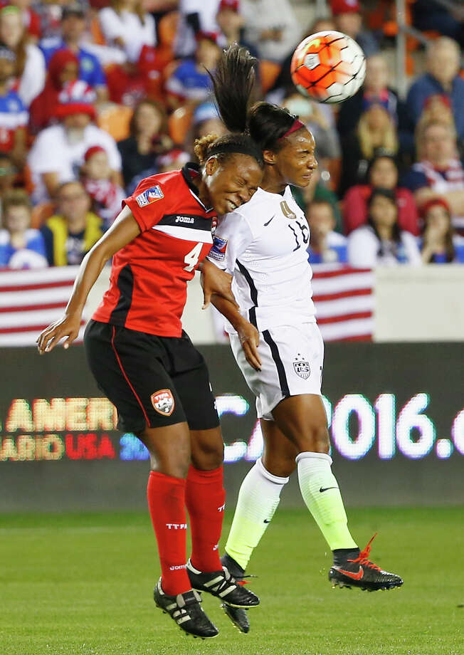 HOUSTON, TX - FEBRUARY 19:  Crystal Dunn #16  of the United States battles for the ball with Danielle Blair #4 of Trinidad and Tobago during their Semifinal of the 2016 CONCACAF Women's Olympic Qualifying at BBVA Compass Stadium on February 19, 2016 in Houston, Texas. Photo: Scott Halleran, Getty Images / 2016 Getty Images