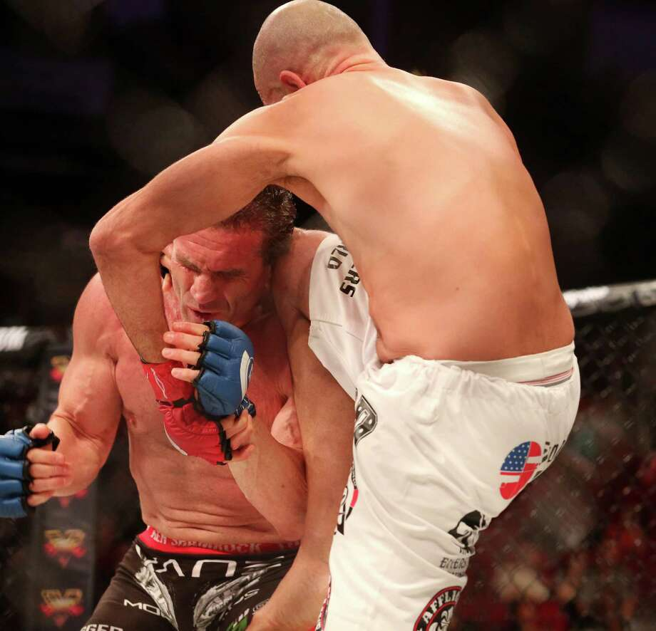 Ken Shamrock is kneed in the head by Royce Gracie during the first round of a heavyweight co-main fight during Bellator 149 at the Toyota Center Friday, Feb. 19, 2016, in Houston. Gracie won with a TKO in the first round. Photo: Jon Shapley, Houston Chronicle / © 2015  Houston Chronicle