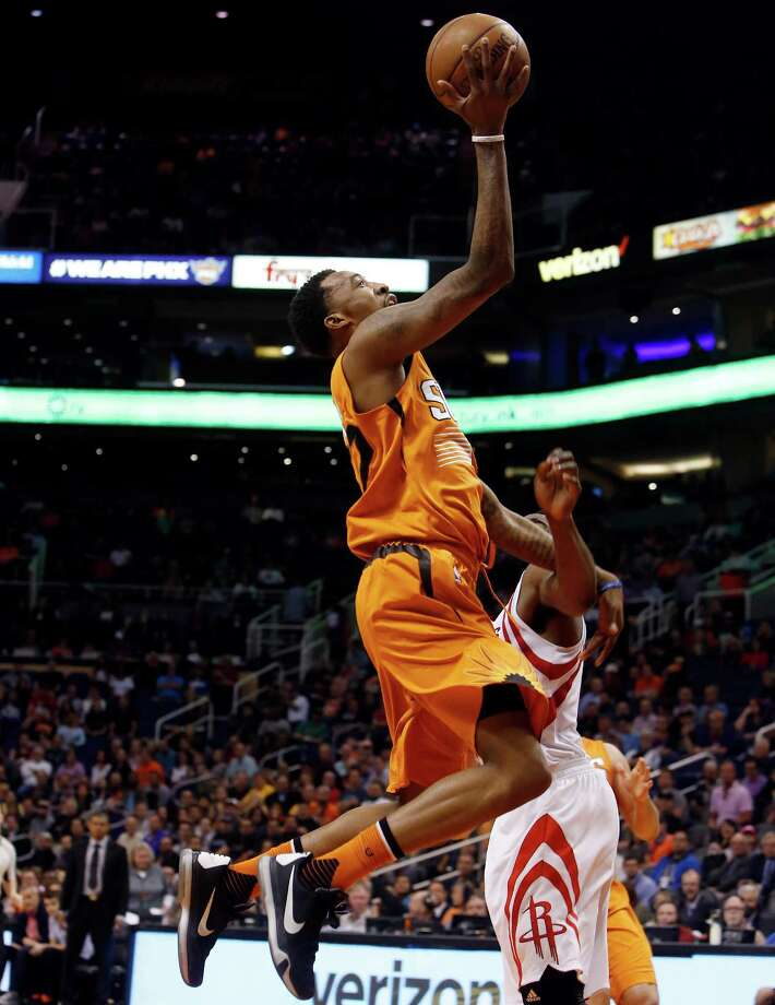 Phoenix Suns guard Jordan McRae, drives on Houston Rockets guard James Harden during the third quarter of an NBA basketball game Friday, Feb. 19, 2016, in Phoenix. The Rockets defeated the Suns 116-100. (AP Photo/Rick Scuteri) Photo: Rick Scuteri, Associated Press / FR157181 AP