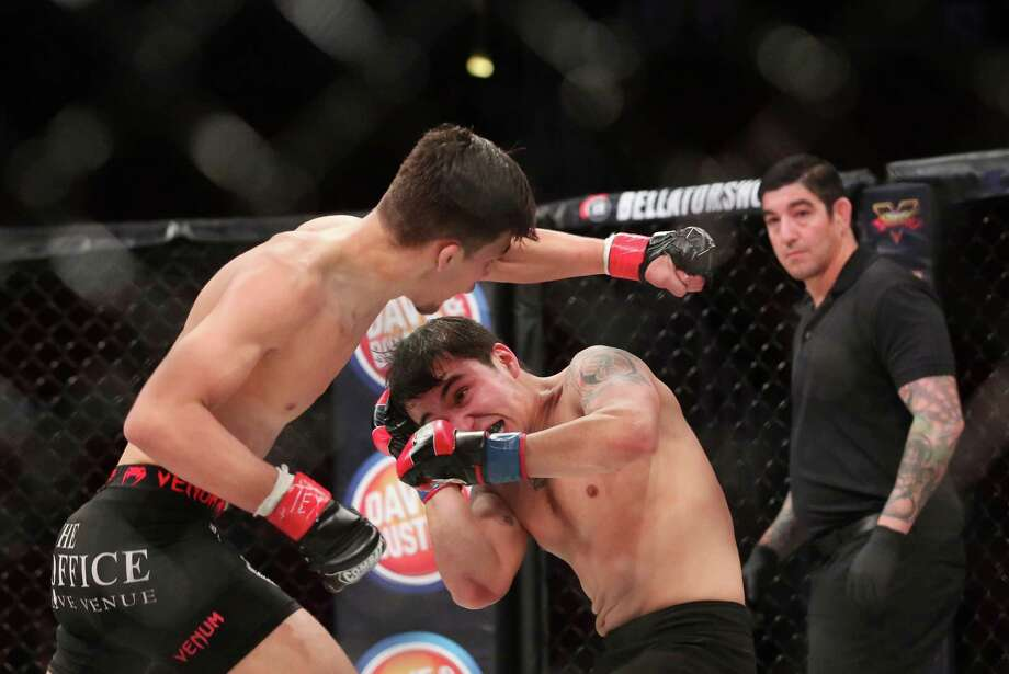 Shawn Solis dodges a punch from Jonathan Davis during the second round of an amateur fight following Bellator 149 at the Toyota Center Friday, Feb. 19, 2016, in Houston. Solis won the fight by unanimous decision. Photo: Jon Shapley, Houston Chronicle / © 2015  Houston Chronicle