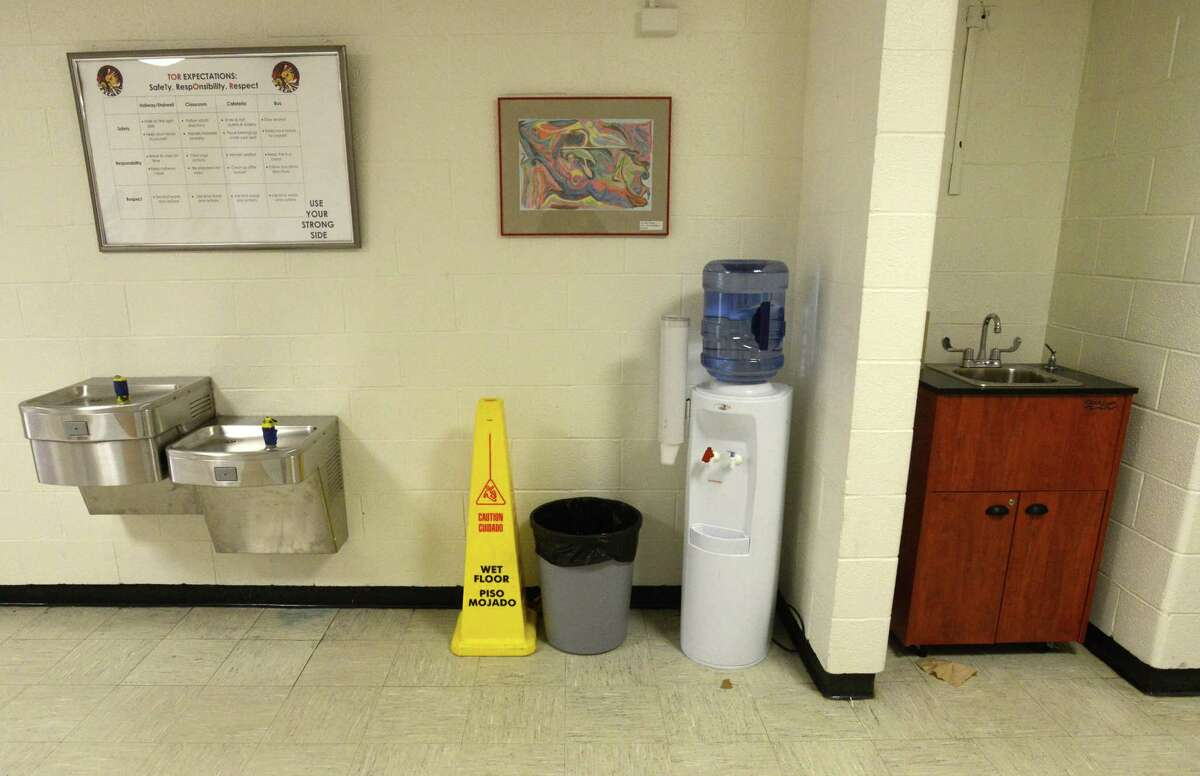 Disable water fountains have been temporarily replaced by portable water and wash stations, shown in this photo taken on Feb. 19, 2016 at Turn of River Middle School in Stamford, Conn., as repairs continue to replace the main water lines into the building that failed back on Jan. 18, 2016.